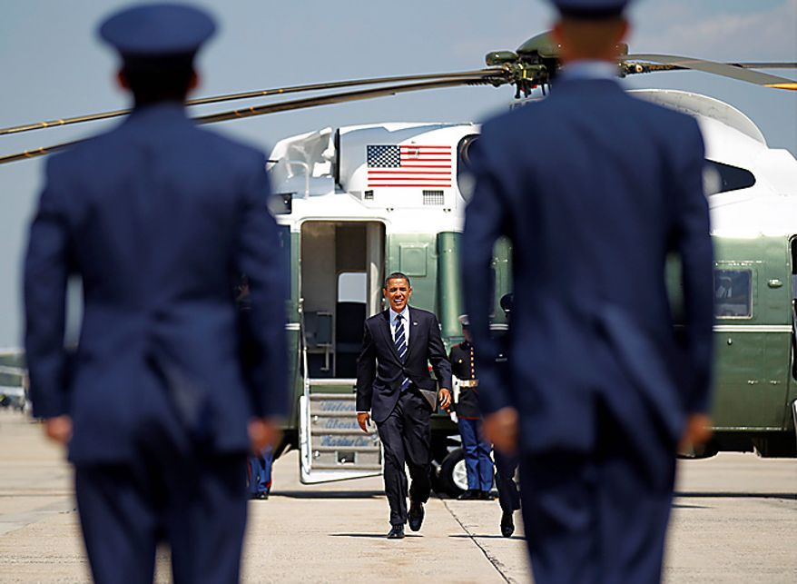 President Barack Obama prepares to board Air Force One before his departure from Andrews Air Force Base, Md., Wednesday, Sept., 8, 2010. (AP Photo/Pablo Martinez Monsivais)