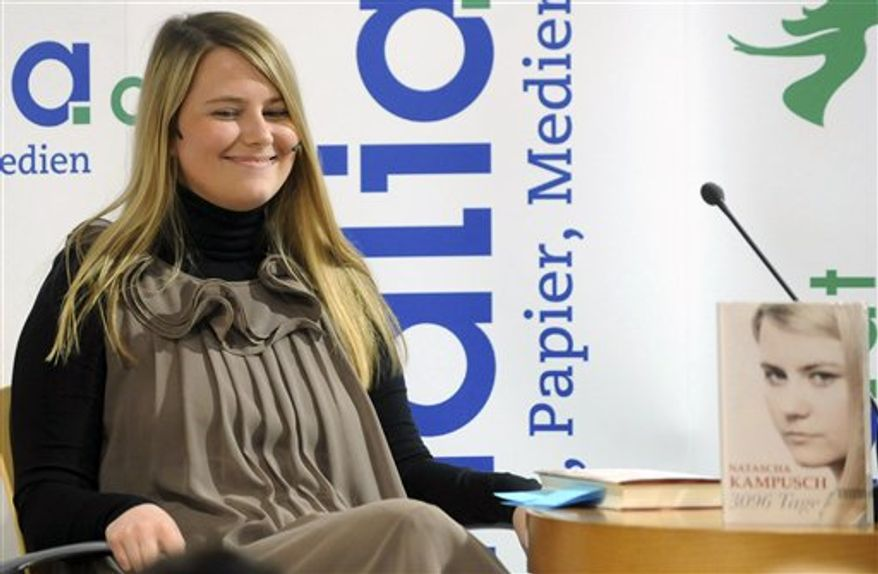 "Natascha Kampusch reacts, during the presentation of her book ""3,096 Tage"" (3,096 Days) at a book store in Vienna, Austria, on Thursday, Sept. 9, 2010. Kampusch, who was kidnapped at age 10 says she was repeatedly beaten, starved and forced to do housework half-naked during her 8 1/2 years at the mercy of a man who admired Hitler and considered himself an Egyptian god. (AP Photo/Helmut Fohringer, Pool)"