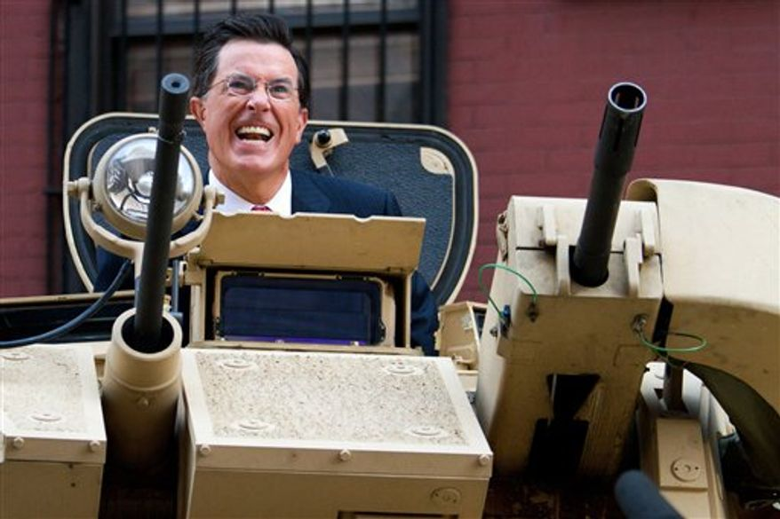 Stephen Colbert rides an Army ASV while taping an episode of the Colbert Report on West 54th Street in New York, Wednesday, Sept. 8, 2010. (AP Photo/Charles Sykes)
