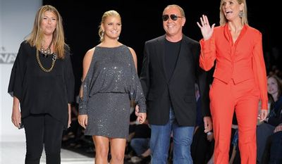 From left, judges Nina Garcia, Jessica Simpson, Michael Kors and Heidi Klum attend the Project Runway Season 8 finale fashion show at the Theatre at Lincoln Center during Mercedes Benz Fashion Week on Thursday, Sept. 9, 2010 in New York. (AP Photo/Evan Agostini)