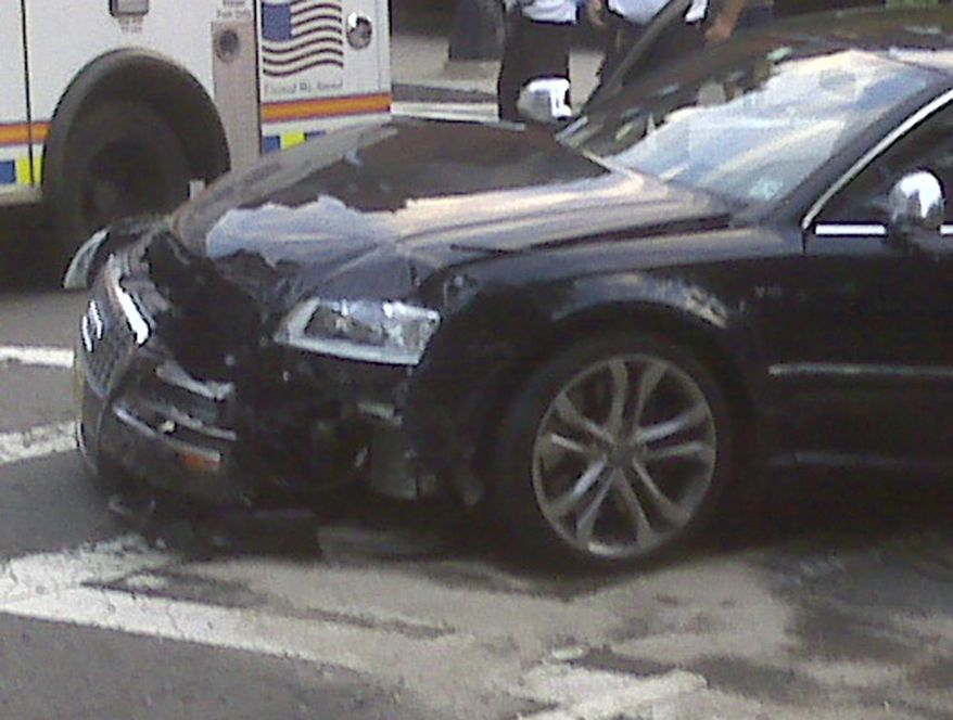 This cell phone photo provided by John McMahon shows an automobile driven by New England Patriots quarterback Tom Brady after it was involved in an early morning accident in Bosto on Thursday, Sept. 9, 2010. (AP Photo/John McMahon)