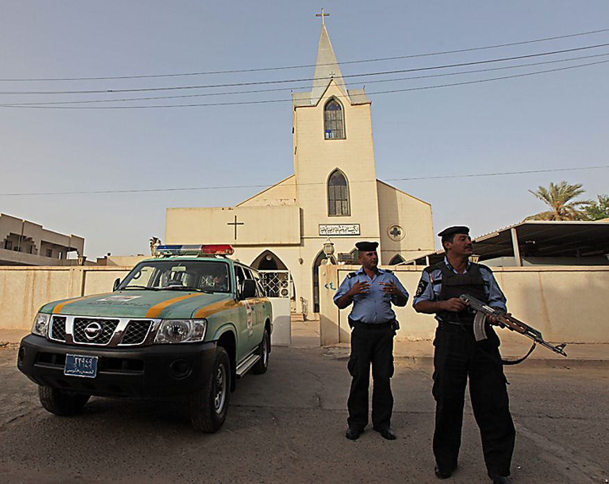 Iraqi policemen stand guard outside Evangelical Protestant church in Baghdad, Iraq, Thursday, Sept. 9, 2010. There are fears of a backlash against Christians in predominantly Muslim countries. Canon Andrew White, the chaplain of an Anglican church in Baghdad, said the Iraqi military had warned him that his church had been threatened. Security was beefed up around the Church of Virgin Mary in central Baghdad on Thursday, with military vehicles blocking the entrance to the church and more soldiers were deployed to guard it. (AP Photo/Khalid Mohammed)