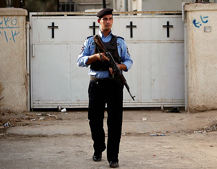 An Iraqi policeman stands guard outside Evangelical Protestant churchin Baghdad, Iraq, Thursday, Sept. 9, 2010. There are fears of a backlash against Christians in predominantly Muslim countries. Canon Andrew White, the chaplain of an Anglican church in Baghdad, said the Iraqi military had warned him that his church had been threatened. Security was beefed up around the Church of Virgin Mary in central Baghdad on Thursday, with military vehicles blocking the entrance to the church and more soldiers were deployed to guard it. (AP Photo/Khalid Mohammed)
