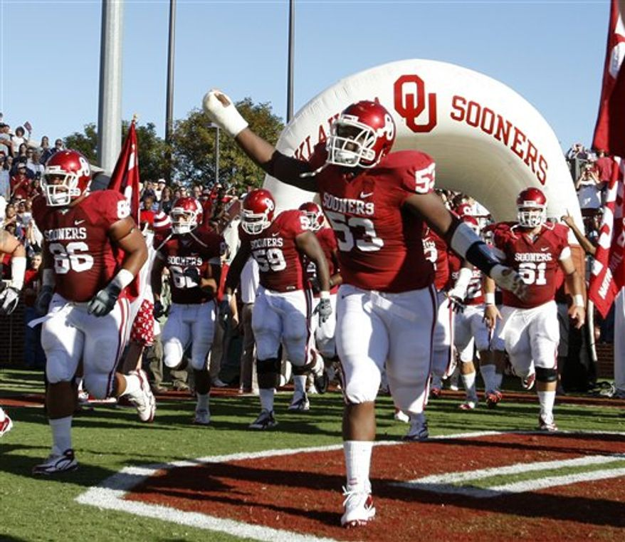 The Oklahoma team takes the field before the start of their NCAA college football game against Utah State in Norman, Okla., Saturday, Sept. 4, 2010. (AP Photo/Sue Ogrocki)