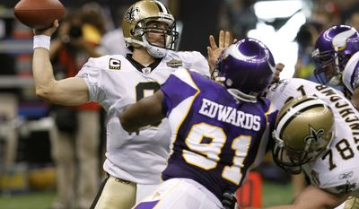 ASSOCIATED PRESS Minnesota Vikings defender Ray Edwards (91) pressures New Orleans Saints quarterback Drew Brees during the first half of an NFL football game in New Orleans, Thursday, Sept. 9, 2010.