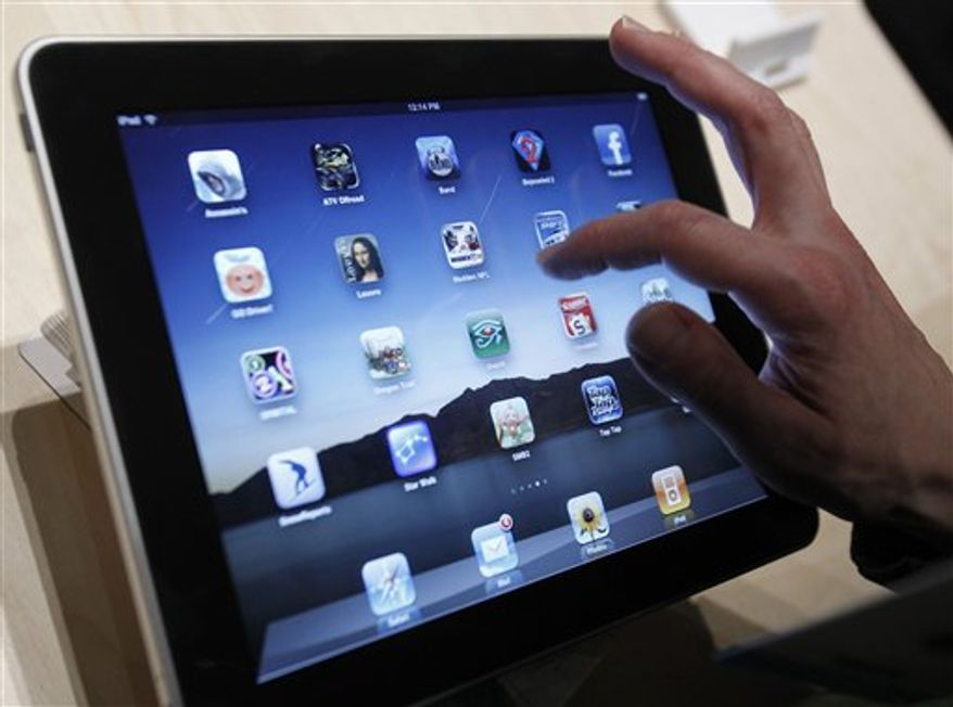 FILE - In this Jan. 27, 2010 file photo, the iPad is shown after it was unveiled at the Moscone Center in San Francisco.  (AP Photo/Marcio Jose Sanchez, FILE)