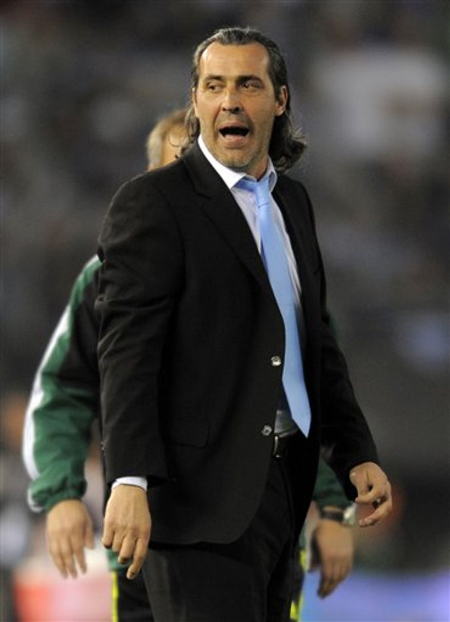 Argentina's coach Sergio Batista reatcs during a friendly soccer match against Spain in Buenos Aires, Argentina, Tuesday Sept. 7, 2010. Argentina won 4-1. (AP Photo/Jorge Araujo)