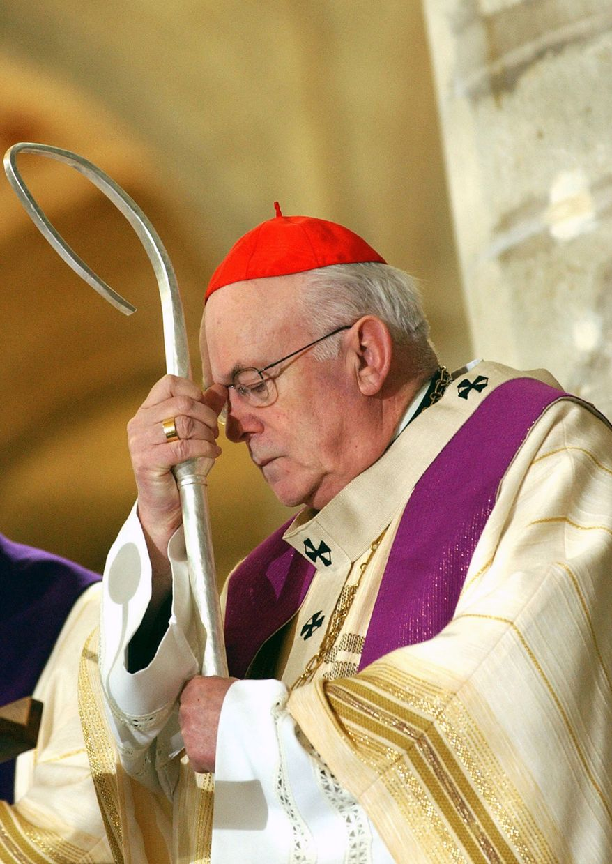 In this Sunday, April 3, 2005, file photo Belgian Cardinal Godfried Danneels leans on his staff while leading a memorial Mass for Pope John Paul II, at the St. Michael church in Brussels. (AP Photo/Virginia Mayo, File)