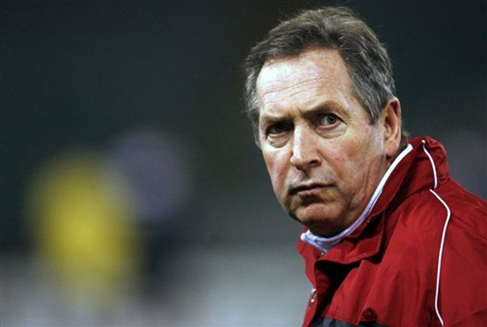 FILE - In this Nov. 21, 2006 file photo, Lyon's coach Gerard Houllier reacts during their Group E Champions League soccer match against Real Madrid at the Santiago Bernabeu Stadium in Madrid. Houllier has reportedly agreed a two-year contract to become manager of Aston Villa, L'Equipe newspaper reported Tuesday, Sept. 7, 2010 on its website. (AP Photo/Jasper Juinen, File)