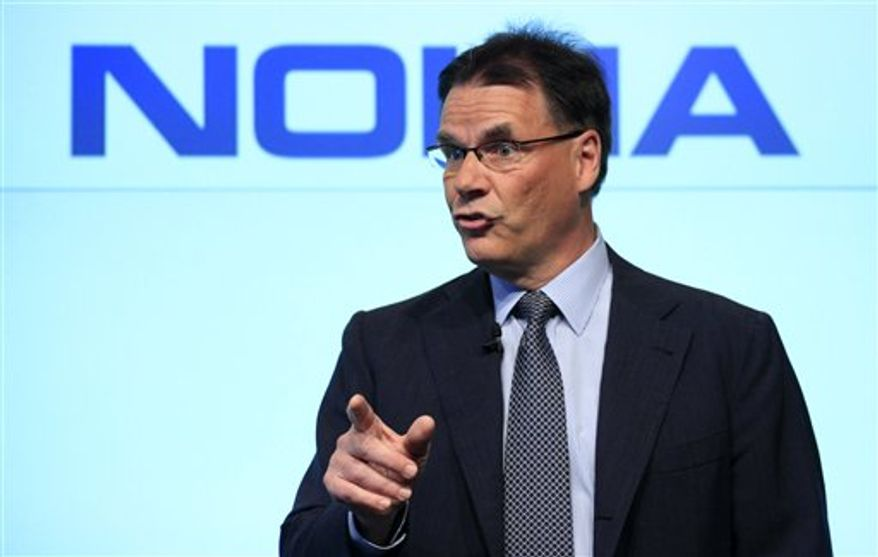 FILE - A Monday, May 24, 2010 photo from files of Olli-Pekka Kallasvuo, CEO of Nokia,as he talks during a news conference in New York. Nokia Corp. will replace CEO Olli-Pekka Kallasvuo with Stephen Elop from Microsoft on Sept. 21, the world's largest handset maker said Friday, Sept. 10, 2010, as it struggles to keep pace with smaller and more innovative rivals, particularly in the smartphone market. With Nokia stock down more than 20 percent this year due to two profit warnings, the Nokia veteran Kallasvuo had come under increasing pressure amid speculation he would be ousted. (AP Photo/Mark Lennihan, File)