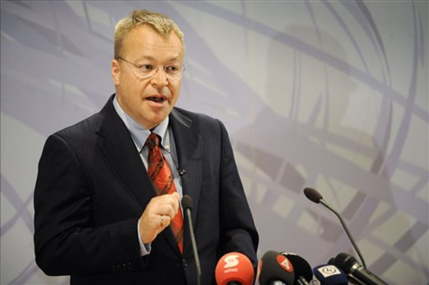 Nokia's new Chief Executive, Stephen Elop, left, and Nokia's Chairman of the Board Jorma Ollila during the press conference Friday, Sept. 10, 2010, in Espoo, Finland.  Nokia Corp,  said on Friday that Chief Executive Olli-Pekka Kallasvuo will be replaced by Head of Microsoft's Business Division Stephen Elop on September 21. (AP Photo/Lehtikuva, Markku Ulander)