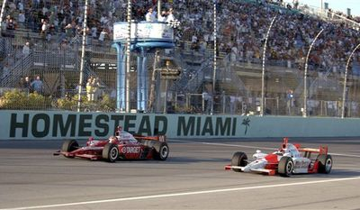 FILE - In this March 26, 2006, file photo provided by the IRL, Dan Wheldon left, of England, defeats Helio Castroneves, of Brazil, to win the IndyCar Series auto race at Homestead-Miami Speedway in Homestead, Fla. Indy Racing League CEO Randy Bernard has confirmed that Homestead-Miami is off the 2011 schedule for the open-wheel series. (AP Photo/IRL, Jim Haines)