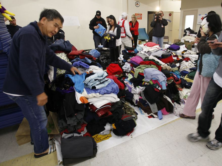 Evacuees look for donated clothing at a Red Cross shelter in San Bruno, Calif., Friday, Sept. 10, 2010, following a massive fire in their neighborhood on Thursday. (AP Photo/Paul Sakuma)
