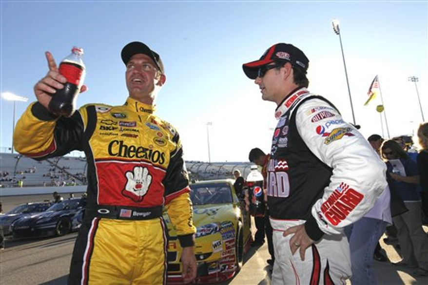 Carl Edwards, right, talks with crew chief Bob Osborne during qualifying for the Air Guard 400 Sprint Cup race at the Richmond International Raceway in Richmond, Va., Friday, Sept. 10, 2010. Edwards won the pole for Saturday's race. (AP Photo/Steve Helber)