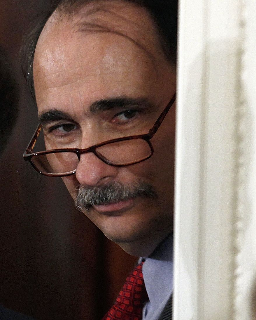 Senior White House Adviser David Axelrod listens from a doorway as President Barack Obama answers questions during a news conference in the East Room of the White House in Washington, Friday, Sept. 10, 2010. (AP Photo/Charles Dharapak)