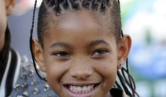 """FILE - In this June 24, 2010 file photo, actress and singer Willow Smith arrives at the premiere of """"The Twilight Saga: Eclipse"""" in Los Angeles.  (AP Photo/Chris Pizzello, file)"""