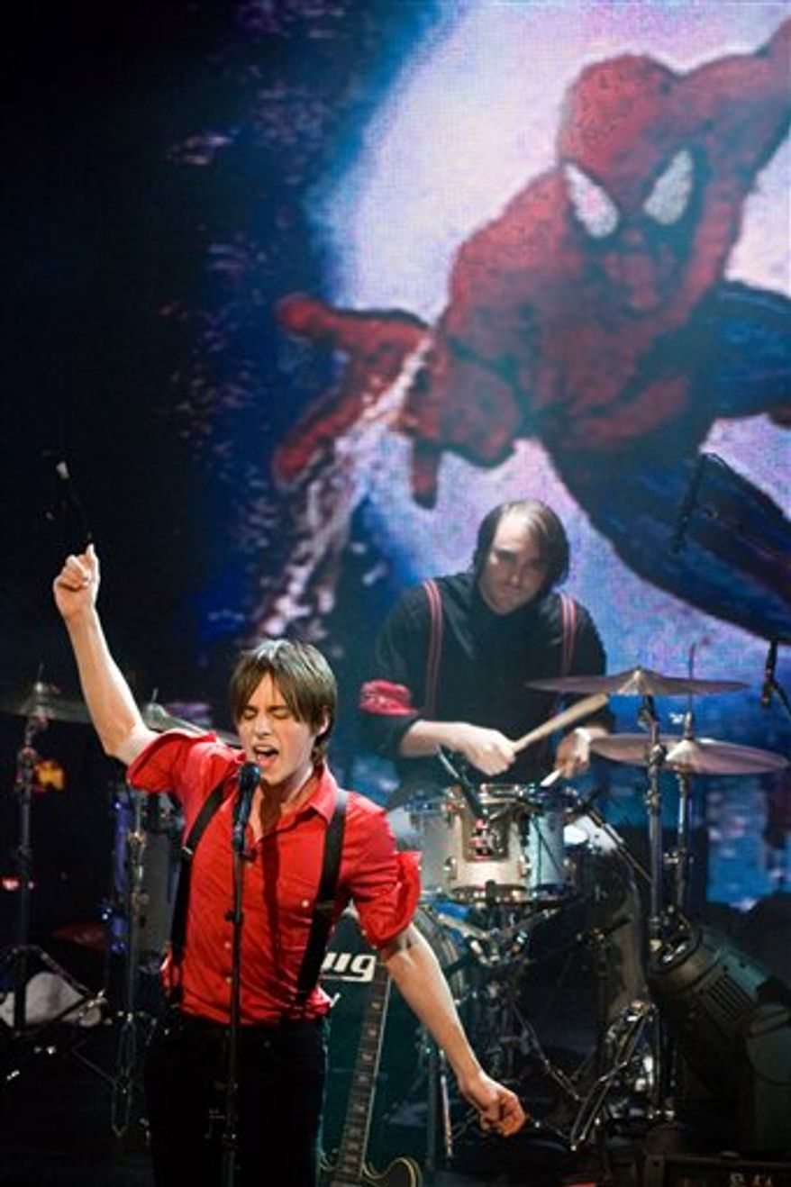 """Director Julie Taymor, left, and Reeve Carney, star of Broadway's upcoming """"Spider-Man Turn Off The Dark"""", appear on stage during ABC's """"Good Morning America"""" show in New York, Friday, Sept. 10, 2010. (AP Photo/Charles Sykes)"""