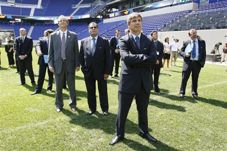 An electronic sign reads, The Game Is In US, as a FIFA Inspection Delegation and others arrive at the New Meadowlands stadium Tuesday, Sept. 7, 2010, in East Rutherford, N.J., on their tour of various stadiums in preparation for choosing a site for the 2018 or 2022 World Cup.  (AP Photo/Mel Evans)