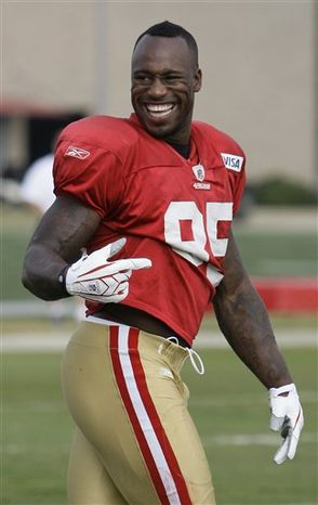 FILE - In this Aug. 3, 2010, file photo, San Francisco 49ers tight end Vernon Davis smiles during NFL football training camp in Santa Clara, Calif. Davis signed a five-year extension with the San Francisco 49ers on Saturday making him the highest-paid tight end in NFL history. (AP Photo/Jeff Chiu, File)