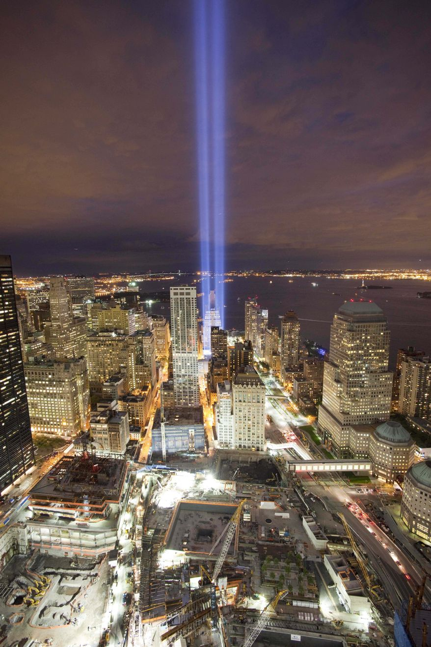 The Tribute in Light shines above the World Trade Center site, bottom, and the lower Manhattan skyline, Friday, Sept. 10, 2010, in New York. Saturday will be the ninth anniversary of the attacks on the World Trade Center. (AP Photo/Mark Lennihan)