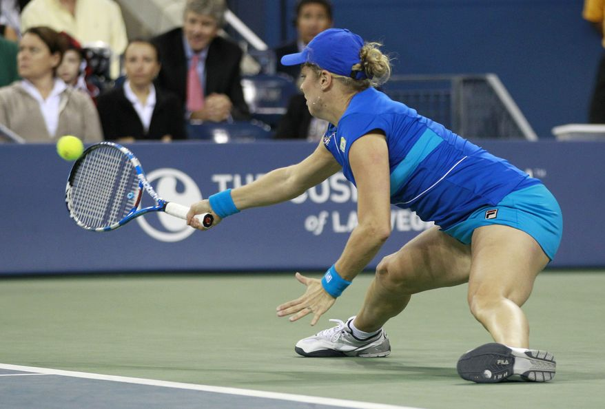 Kim Clijsters, of Belgium, returns the ball to Vera Zvonareva, of Russia, during the women's championship match at the U.S. Open tennis tournament in New York, Saturday, Sept. 11, 2010. (AP Photo/Charles Krupa)