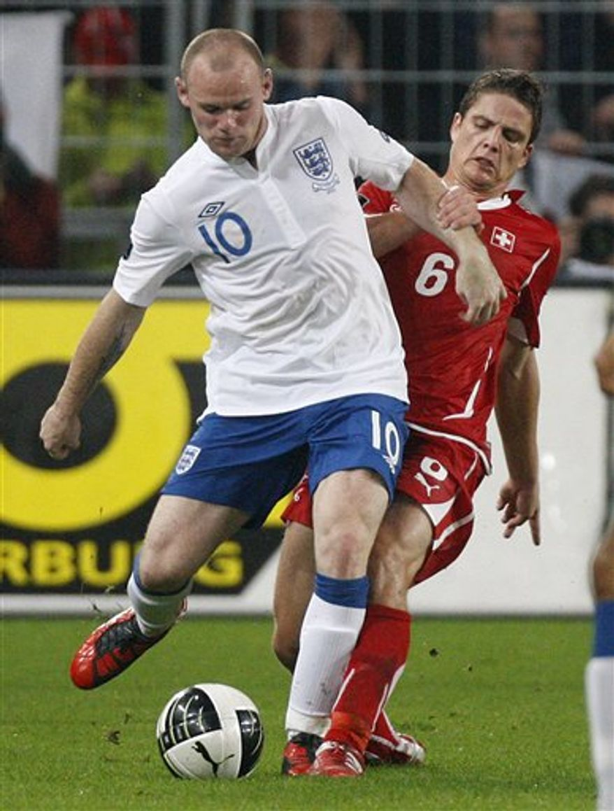 FILE - Manchester United and  England player Wayne Rooney in action during their Euro 2012 Group G qualifying soccer match in Basel, Switzerland, Tuesday, Sept. 7, 2010. Rooney was conspicuous by his absence Saturday Sept 11 2010  as his current Manchester United side prepared to take on former club Everton at Goodison Park. Tabloid newspapers have reported  that Rooney cheated repeatedly on his then-pregnant wife Coleen last year with a prostitute, leading to daily front and backpage stories about the Manchester United player's private life.(AP Photo/Michael Probst, file)