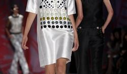 A model wears fashion from the Cynthia Rowley Spring 2011 collection, Saturday, Sept. 11, 2010, during Fashion Week in New York. (AP Photo/Bebeto Matthews)