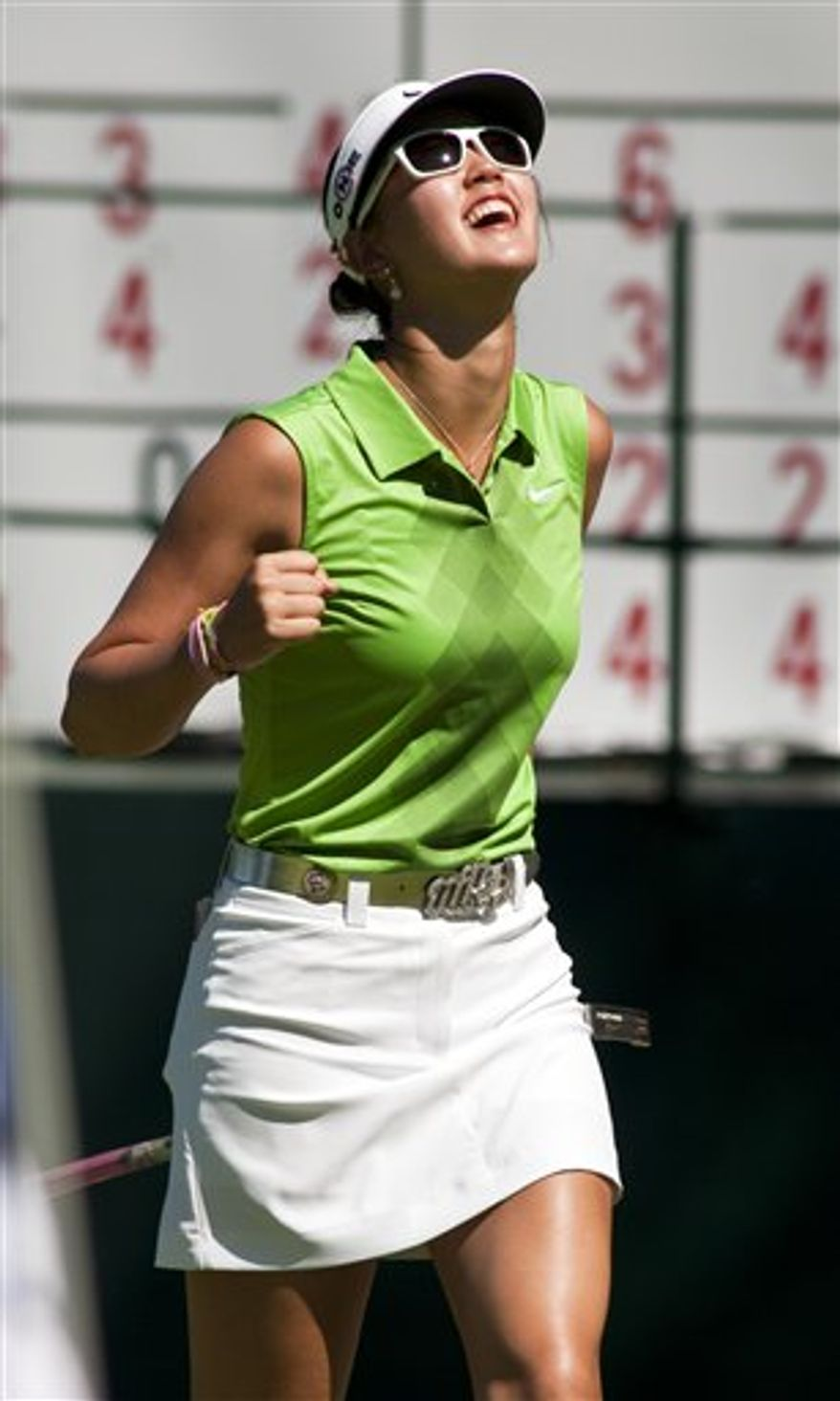 Michelle Wie, right, watches her shot off the third tee as Yani Tseng, left background, looks on during the final round of the P & G Northwest Arkansas Championship golf tournament in Rogers, Ark., Sunday, Sept. 12, 2010. (AP Photo/April L. Brown)
