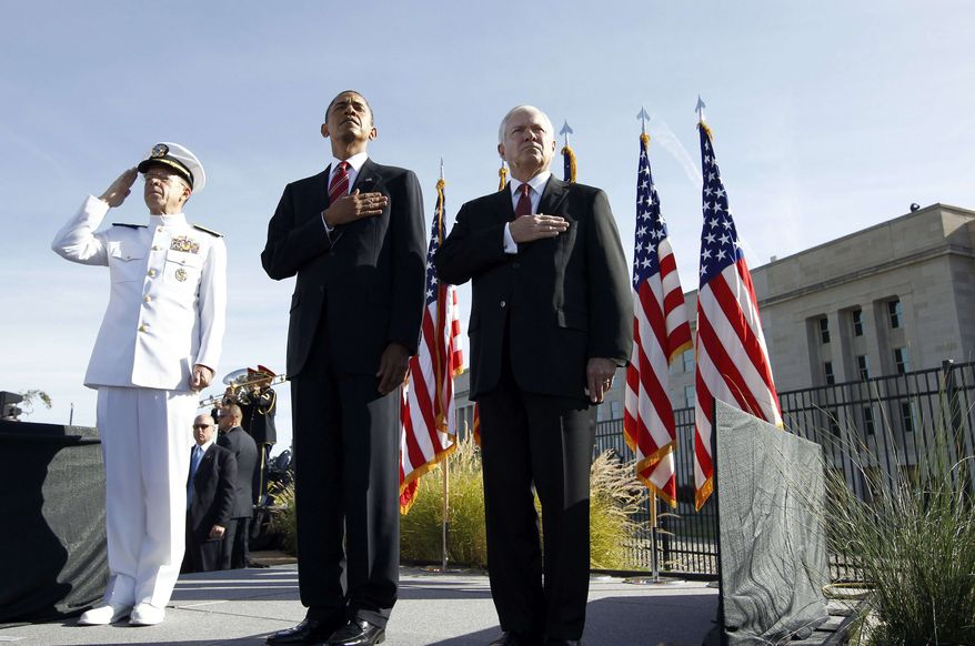 President Barack Obama, flanked by Defense Secretary Robert Gates, right, and Joint Chiefs Chairman Adm. Michael Mullen, at the Pentagon Memorial, marking the ninth anniversary of the September 11 attacks, Saturday, Sept. 11, 2010. (AP Photo/Charles Dharapak)