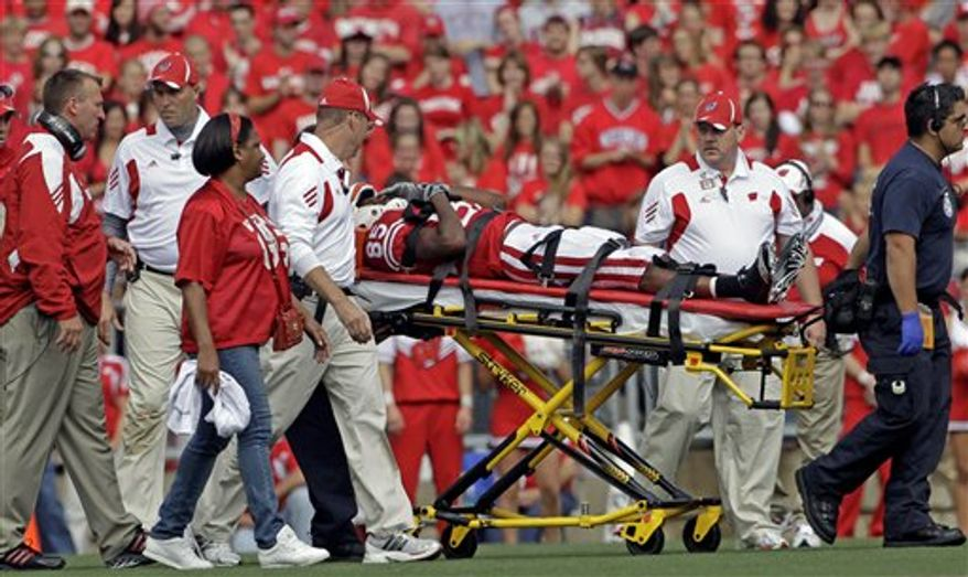 Wisconsin punt returner David Gilreath is taken off the field on a stretcher after getting injured during the second half of an NCAA football game against the San Jose State Saturday, Sept. 11, 2010, in Madison, Wis. Wisconsin won 27-14. (AP Photo/Morry Gash)