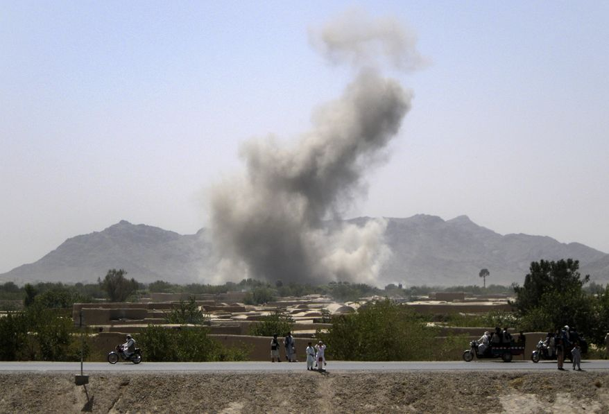 Smoke rises after NATO aircraft conducted an airstrike near the Arghandab River south of the village of Senjeray in Afghanistan's Kandahar province, where U.S. commanders had identified insurgent positions on Saturday, Sept. 11, 2010. (AP Photo/Todd Pitman)