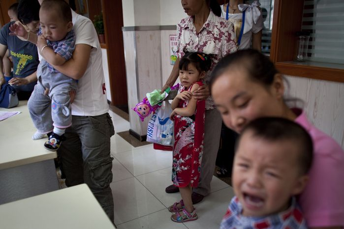 A child cries while waiting Saturday to receive vaccination injection against measles at a clinic in Beijing. China wants to vaccinate nearly 100 million children in a 10-day nationwide campaign starting Saturday to bring it a step closer to eradicating measles. (Associated Press)