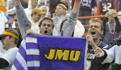 James Madison's Drew Dudzik, right, and Brian Barlow celebrate Dudzik's touchdown against Virginia Tech during the second half of an NCAA college football game  at Lane Stadium in Blacksburg, Va., Saturday, Sept. 11, 2010. (AP Photo/Don Petersen)