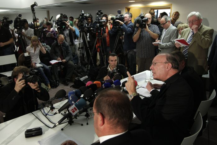 ** FILE ** Archbishop Andre-Joseph Leonard of Mechelen-Brussels gestures as he addresses the media at a media conference in Brussels on Monday, Sept. 13, 2