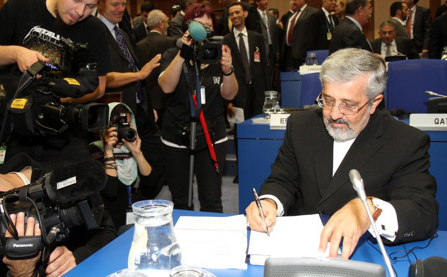 Iran's Ambassador to the International Atomic Energy Agency, Ali Asghar Soltanieh, ckecks his papers prior to the start of the IAEA's board of governors meeting at the International Center, in Vienna, Austria, on Monday, Sept. 13, 2010. (AP Photo/Ronald Zak)