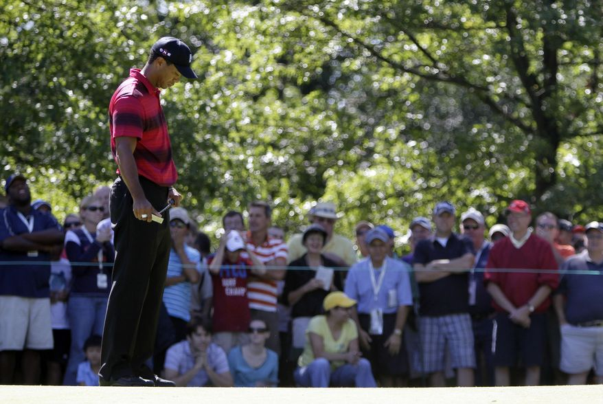 Tiger Woods looks down Sunday after missing a birdie putt on the fourth green during the final round at the BMW Championship golf tournament in Lemont, Ill. (Associated Press)