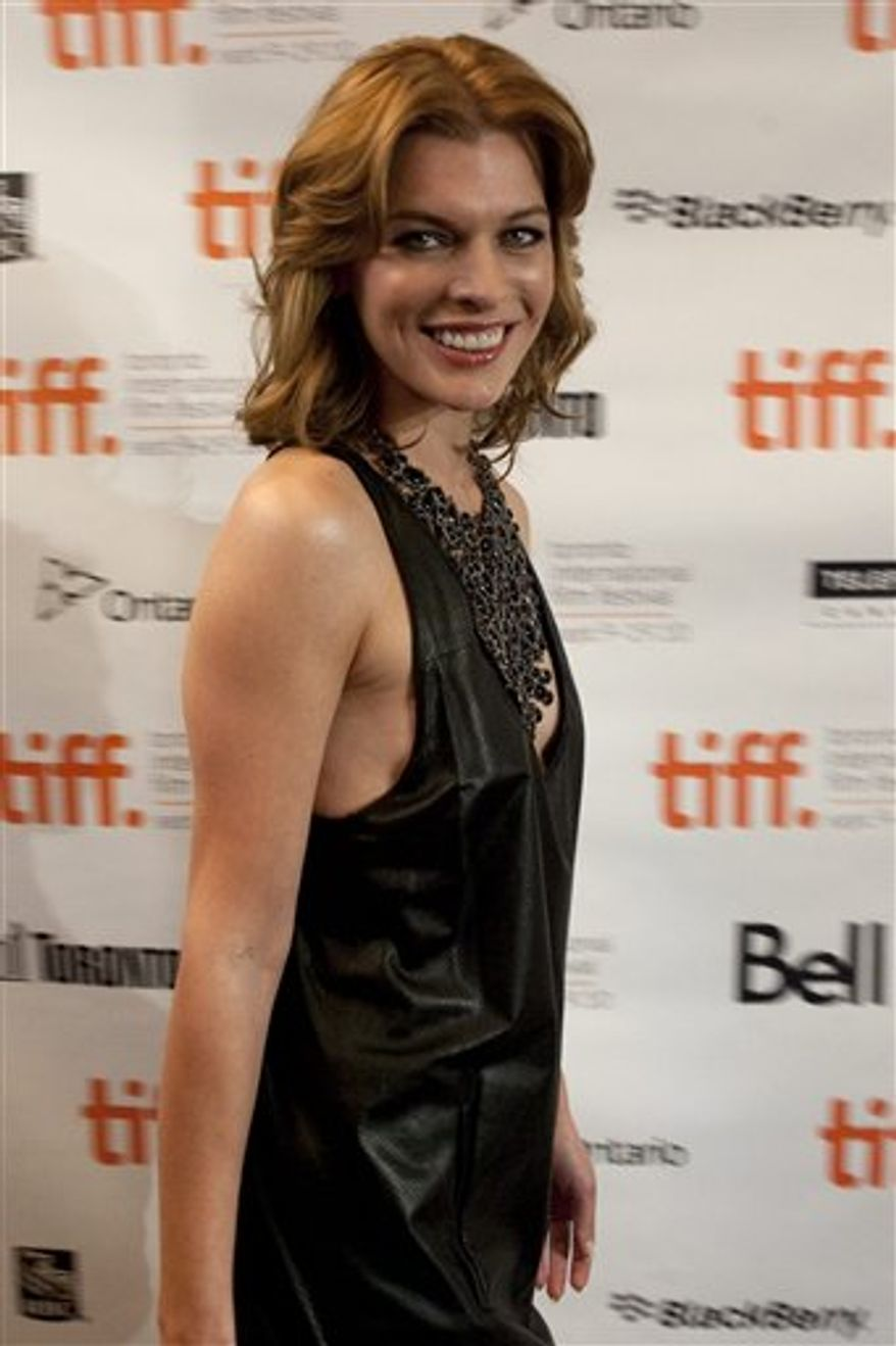 Milla Jovovich  arrives for the premiere of his new film Stone at the Toronto International Film Festival in Toronto on Friday September 10, 2010. (AP Photo/The Canadian Press, Chris Young)