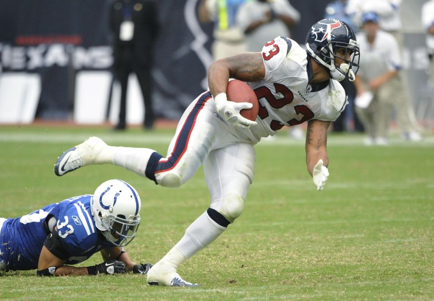 Houston Texans running back Arian Foster (23) breaks away in the fourth quarter from Indianapolis Colts safety Melvin Bullitt (33), en route to his second touchdown of the Texans' 34-24 home win over the Colts. (Associated Press)