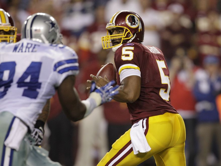 ASSOCIATED PRESS Washington Redskins  quarterback Donovan McNabb (5) drops back to pass against the Dallas Cowboys during the second half of an NFL football game, Sunday, Sept. 12, 2010, in Landover, Md. The Redskins won 13-7.