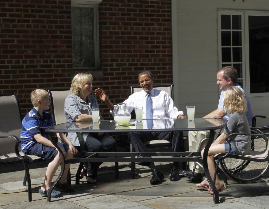 President Obama laughs during his visit to the Fairfax, Va., home of John Nicholas and Nicole Armstrong and their twins, Trevor and Olivia, on Monday, Sept. 13, 2010. (AP Photo/Pablo Martinez Monsivais)