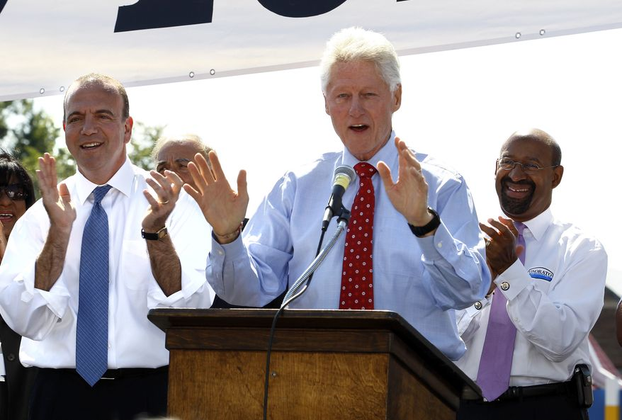 Former President Bill Clinton (center) speaks to supporters at a rally for Dan Onorato (left), Democratic candidate in the primary elections for Pennsylvania governor, on Monday, Sept. 13, 2010, in Philadelphia. At right is Philadelphia Mayor Michael Nutter. (AP Photo/Tom Mihalek)
