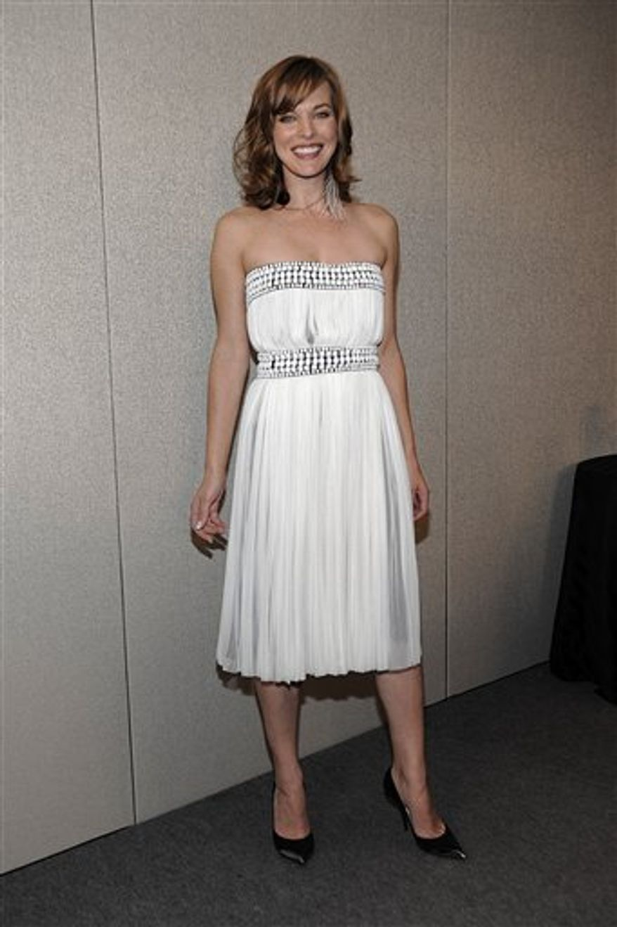 """Actress Milla Jovovich at the TIFF press conference for the feature film """"Stone"""" in Toronto on Friday, Sept. 10, 2010. (AP Photo/Dan Steinberg)"""