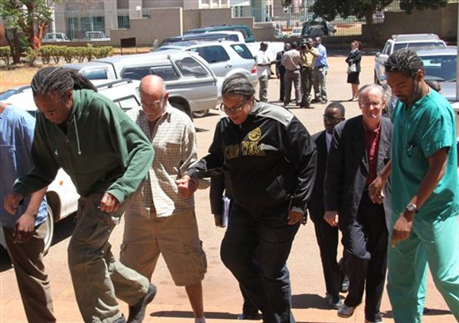 US doctors, from left, Gregory Reinard, David Greenburg, Gloria Cox Cronwell, New Zealand doctor Reid Andrew John,  and US doctor Anthony Eugene Jones, appear at the magistrates courts in Harare, Monday, Sept. 13, 2010. A Zimbabwean court has freed on bail four Americans arrested and accused of treating AIDS patients without proper medical licenses. A magistrate ordered the six health workers, who included a New Zealand national and a Zimbabwean, to pay a $200 bail and to reappear in co