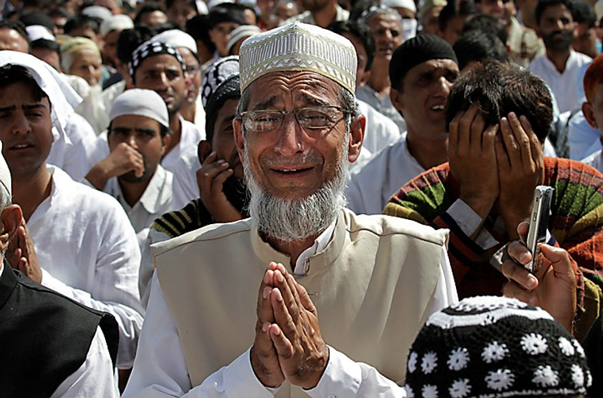 An elderly Kashmiri Muslim cries as he offers Eid al-Fitr prayers in Srinagar, India, Saturday, Sept. 11, 2010. Eid al-Fitr marks the end of the Muslim holy fasting month of Ramadan. The mostly Muslim region has seen near-daily anti-government demonstrations and clashes between protesters and security forces in the past three months which has claimed dozens of lives. (AP Photo/Dar Yasin)