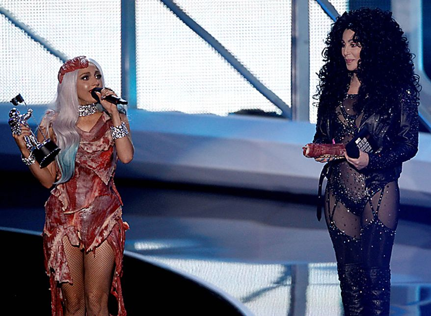 Lady Gaga, left, accepts the award for Video of the Year from Cher at the MTV Video Music Awards on Sunday, Sept. 12, 2010 in Los Angeles. (AP Photo/Matt Sayles)