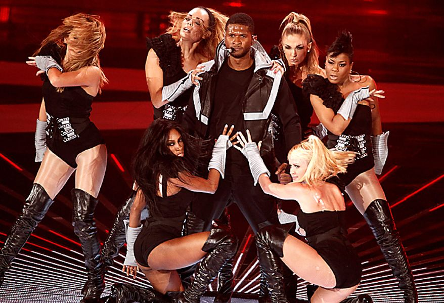 Usher performs at the MTV Video Music Awards on Sunday, Sept. 12, 2010 in Los Angeles. (AP Photo/Matt Sayles)