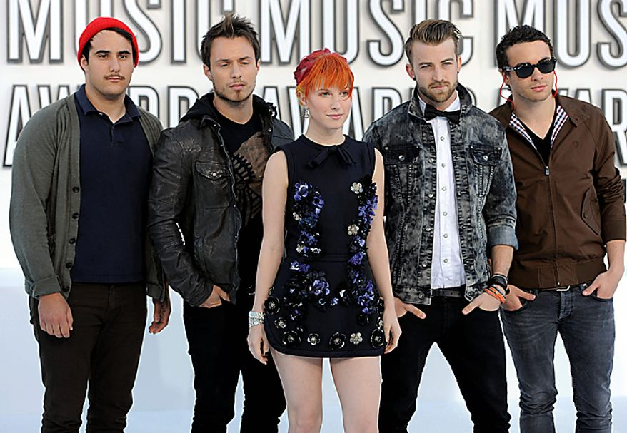 Hayley Williams, center, and Paramore arrive at the MTV Video Music Awards on Sunday, Sept. 12, 2010 in Los Angeles. (AP Photo/Chris Pizzello)