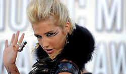 Ke$ha arrives at the MTV Video Music Awards on Sunday, Sept. 12, 2010 in Los Angeles. (AP Photo/Chris Pizzello)