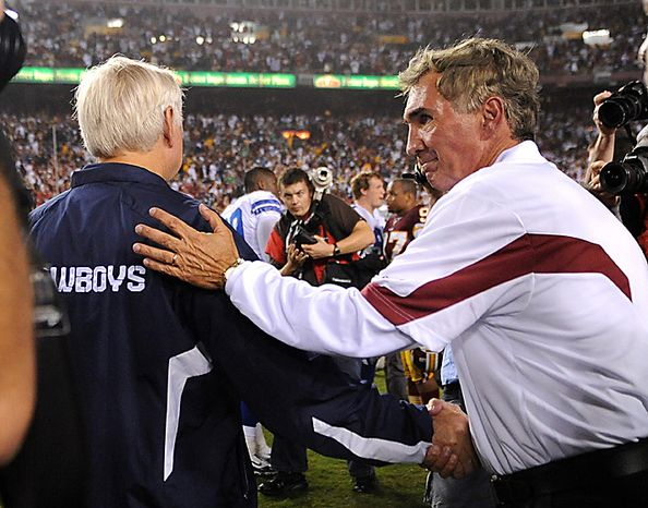 Washington Redskins head coach Mike Shanahan (R) shakes hands with Dallas Cowboys' head coach Wade Phillips after the Redskins defeated the Cowboys 13-7 at FedEx Field in Landover, Maryland on September 12, 2010.  UPI/Kevin Dietsch