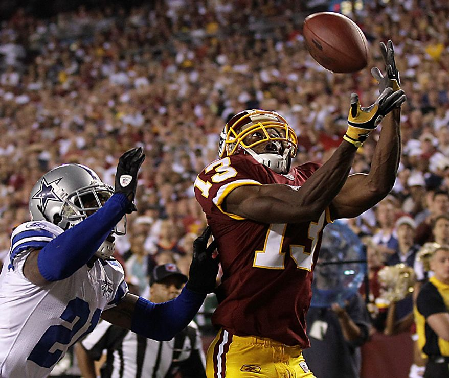 Washington Redskins wide receiver Anthony Armstrong (13) misses a pass in the end zone while being defended by Dallas Cowboys cornerback Mike Jenkins, left, during the second half of an NFL football game, Sunday, Sept. 12, 2010, in Landover, Md. (AP Photo/Rob Carr)